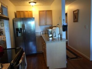 Kitchen showing hallway to bedrooms